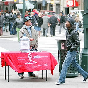 An unidentified man solicits donations for the United Homeless Organization on Seventh Avenue near Penn Station Monday, Nov. 23, 2009 in New York. (N.Y.Post/Chad Rachman)
